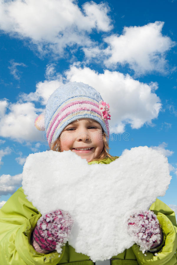 Download Little Girl Keeps In Hands Snow Hearts Stock Image - Image: 17887051
