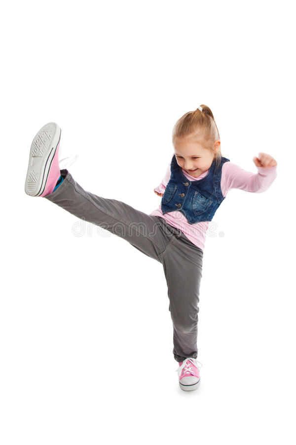 Little girl kick by foot. royalty free stock images