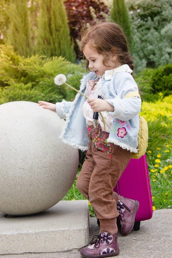 Little girl kid holding dandelion. royalty free stock photography