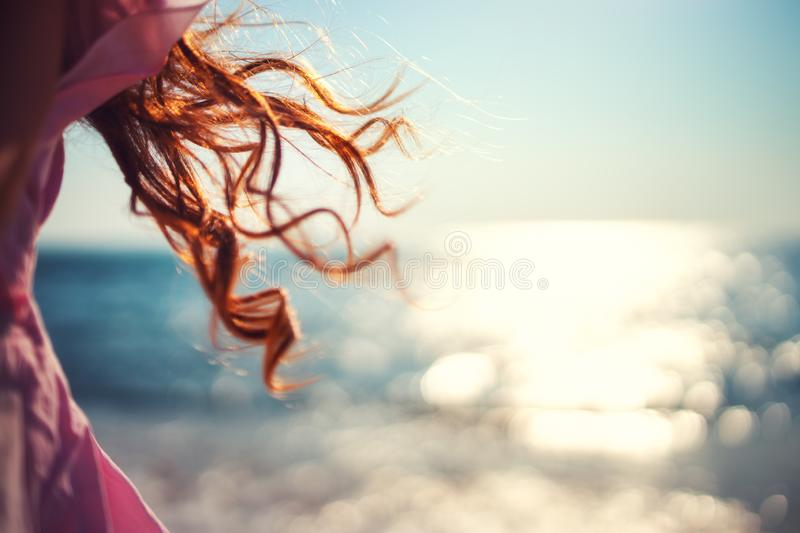Little girl, kid playing on the beach with wind in her hair royalty free stock photos