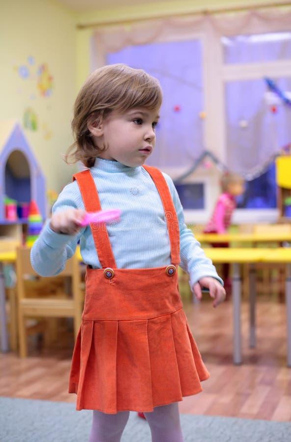 Little girl in kindergarten stock image