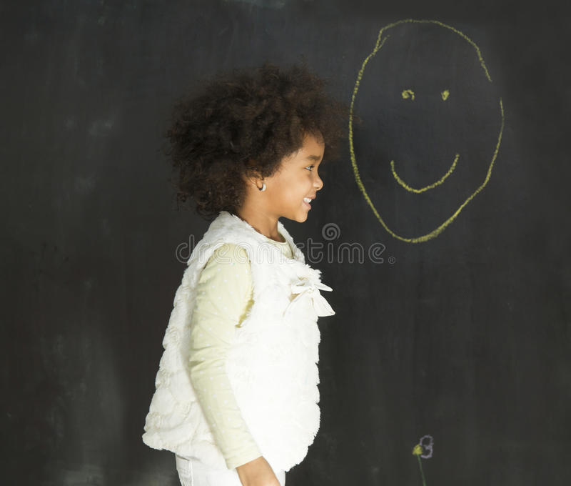 Little girl in the kindergarten stock photo