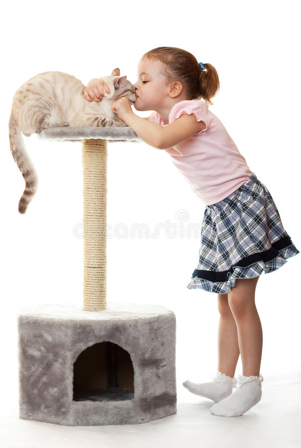 Download Little Girl Kisses Her Cat. Stock Image - Image of curious, calendar: 18987569
