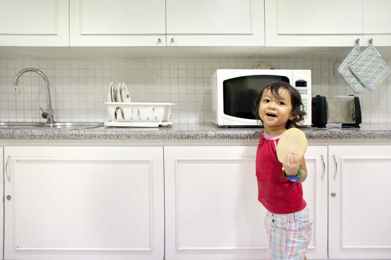 Little girl in kitchen royalty free stock images