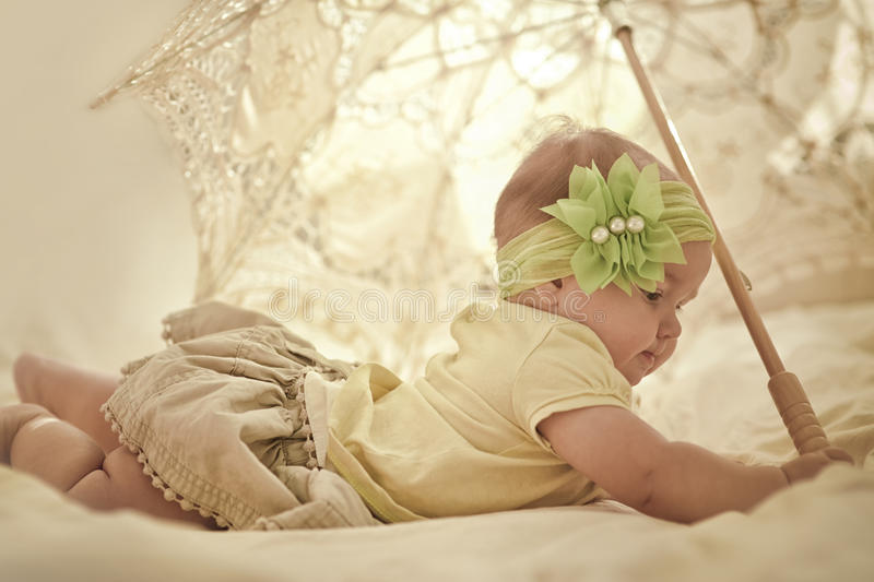 Little girl with lace umbrella stock photos