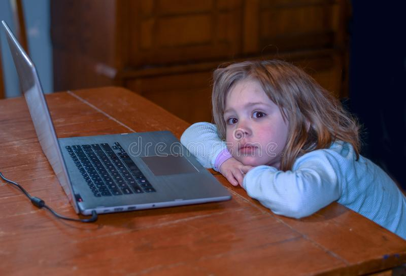 Little girl and a lap top computer royalty free stock photos