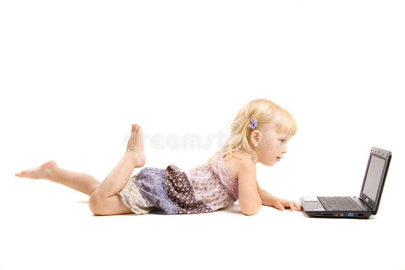 Little girl and laptop stock photo