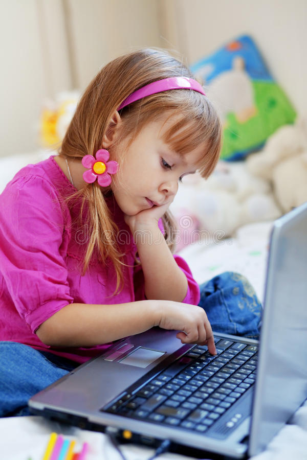 Download Little girl with laptop stock photo. Image of innocent - 11762046