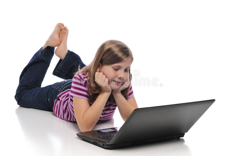 Little girl with laptop royalty free stock images