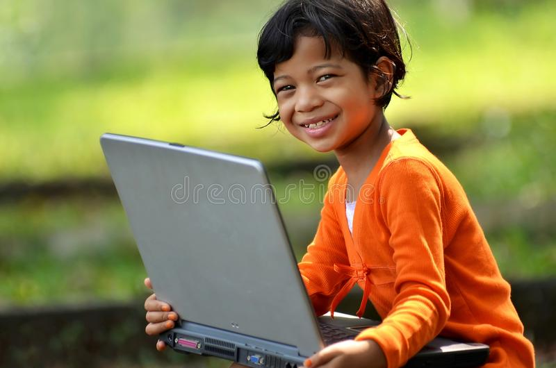Little Girl with a laptop royalty free stock images