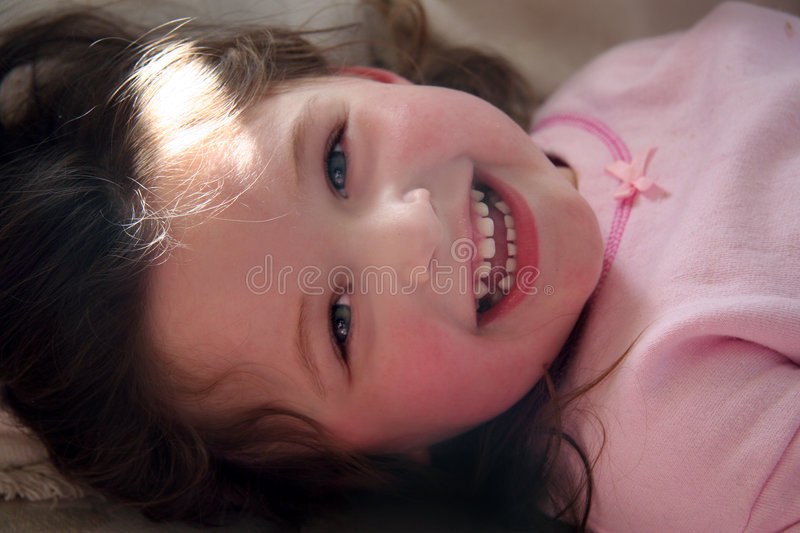 Little girl laughing royalty free stock photos