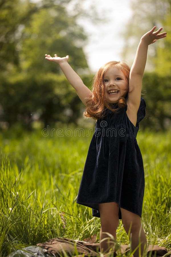 Little girl laughing royalty free stock images