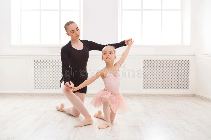 Little girl learn ballet with teacher copy space stock photography