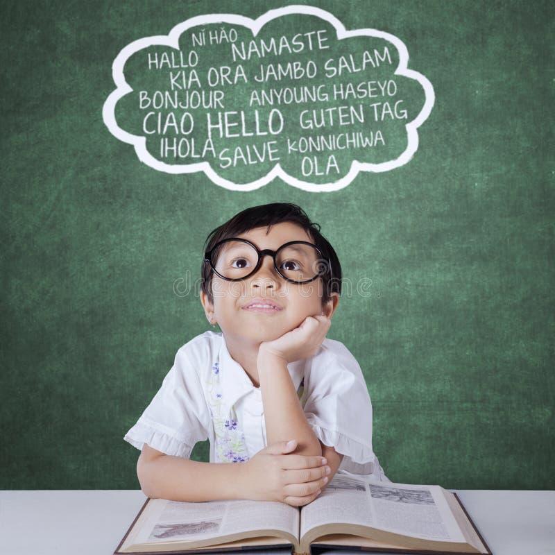 Little girl learning multi language stock image