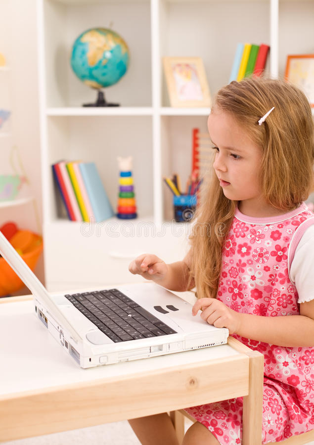 Download Little Girl Learning To Handle A Laptop Computer Stock Photo - Image: 18882208