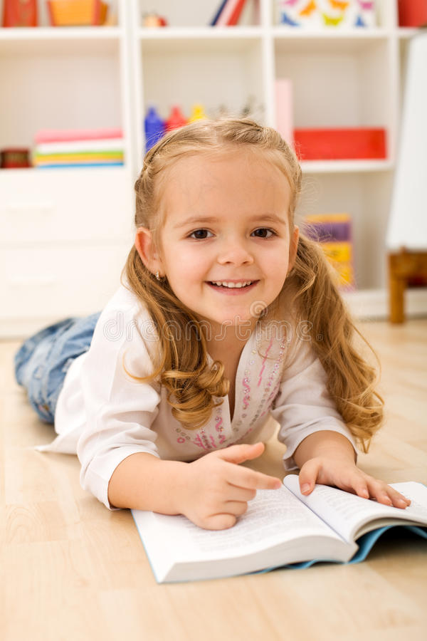 Little Girl Learning To Read Royalty Free Stock Photos