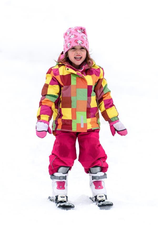 Little girl is learning to ski in ski resort stock photography