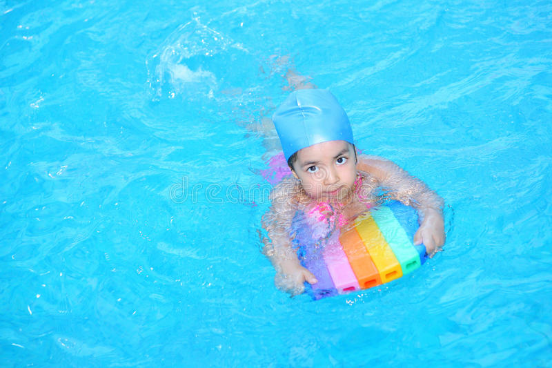 Little girl learning to swim royalty free stock photos