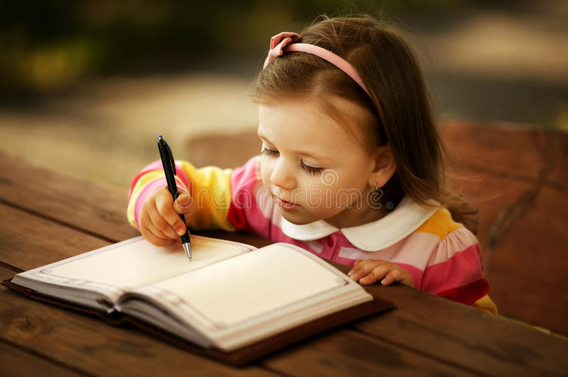 Little girl learning to write royalty free stock photography
