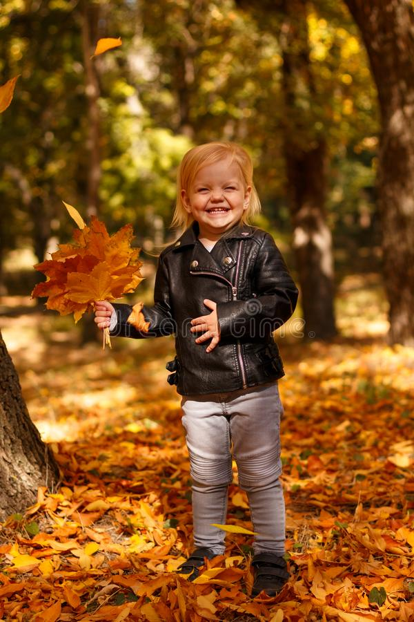 Little girl in a leather jacket royalty free stock photography