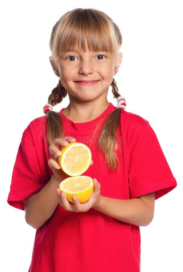 Download Little girl with lemon stock photo. Image of dessert - 27688684
