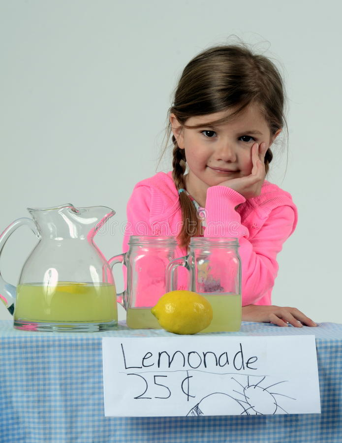 Little girl at lemonade stand waiting for customer royalty free stock photography