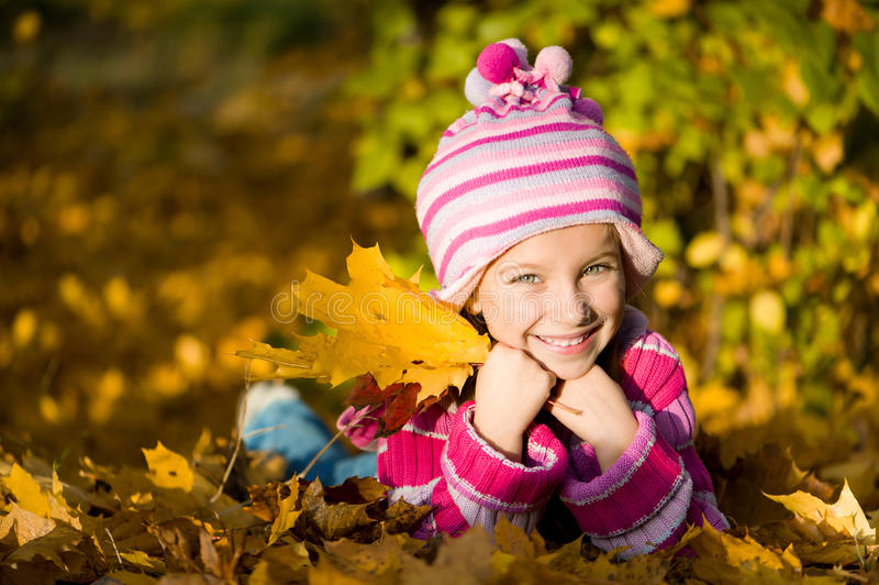 Download Little Girl Lie On The Leaves Royalty Free Stock Image - Image: 27662086