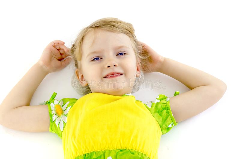 Little girl lies on the floor stock photo