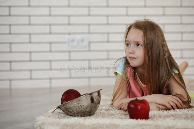 Little girl lies on the floor royalty free stock photo