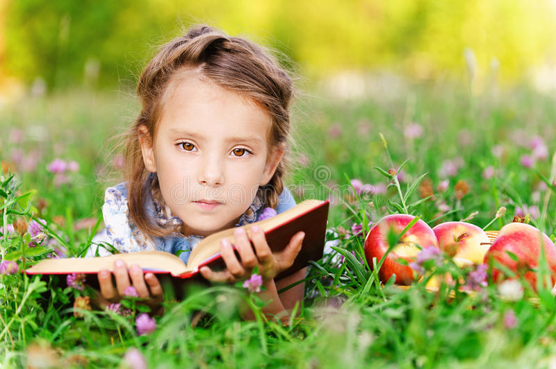 Download Little girl lies on grass stock photo. Image of female - 24585796