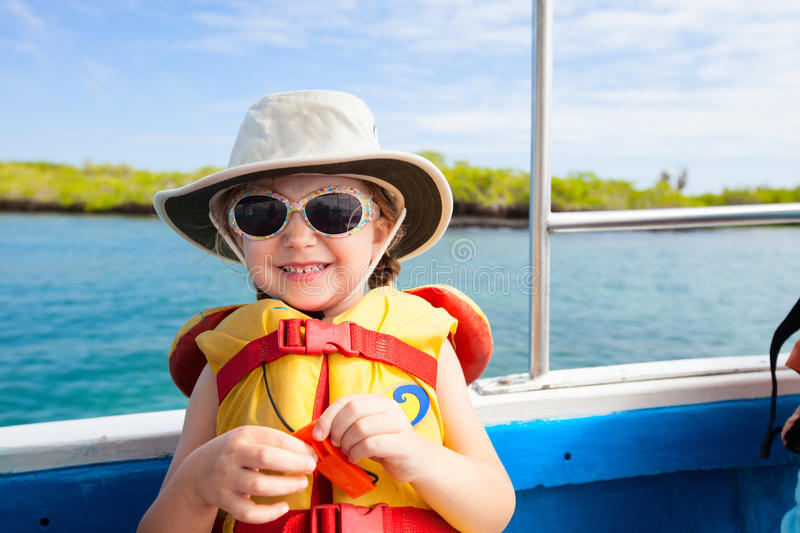 Little girl in a life jacket. Adorable little girl in a life jacket travelling on boat royalty free stock image