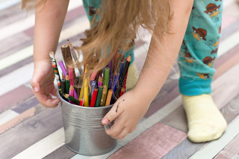 Little girl lifts her pencils. royalty free stock images