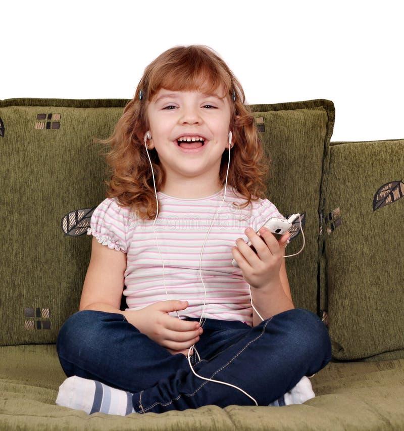 Download Little Girl Listening Music Stock Image - Image: 23400419