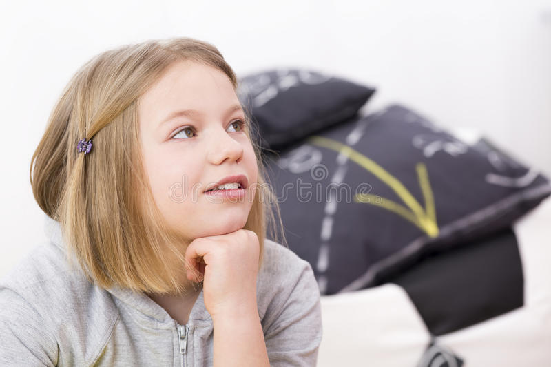 Little girl listening stock photo