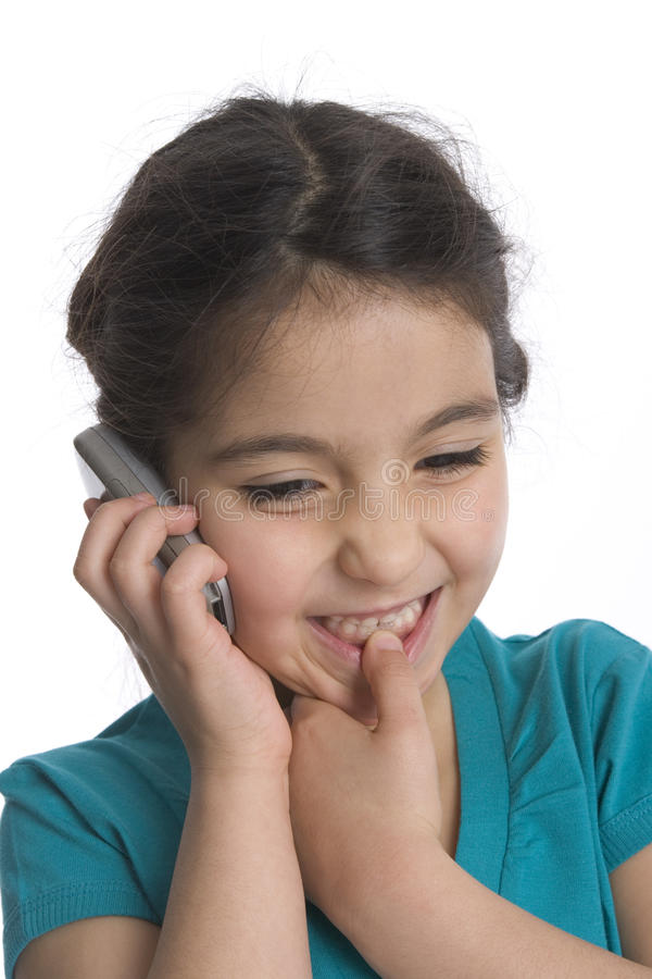 Little Girl Is Is Listening To Her Mobile Phone royalty free stock photo