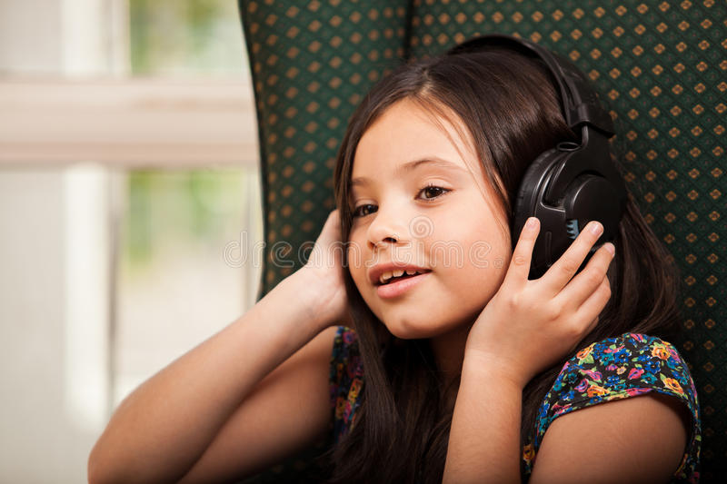 Download Little Girl Listening To Music Stock Photo - Image: 34082510