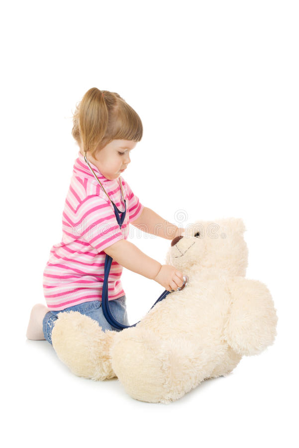 Download Little Girl Listens A Stethoscope To A Toy Bear Stock Image - Image of childhood, isolated: 14274833