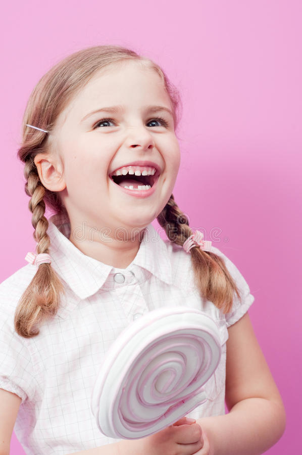 Download Little girl with lollipop stock photo. Image of face - 14439208