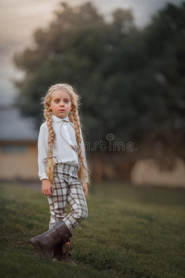 Little girl with long hair in casual style  in summer day stock image