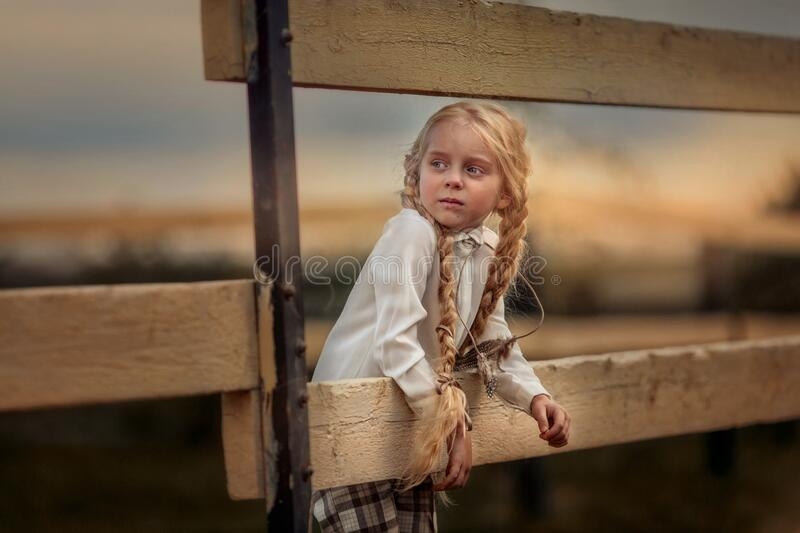 Little girl with long hair in casual style  in summer day stock images