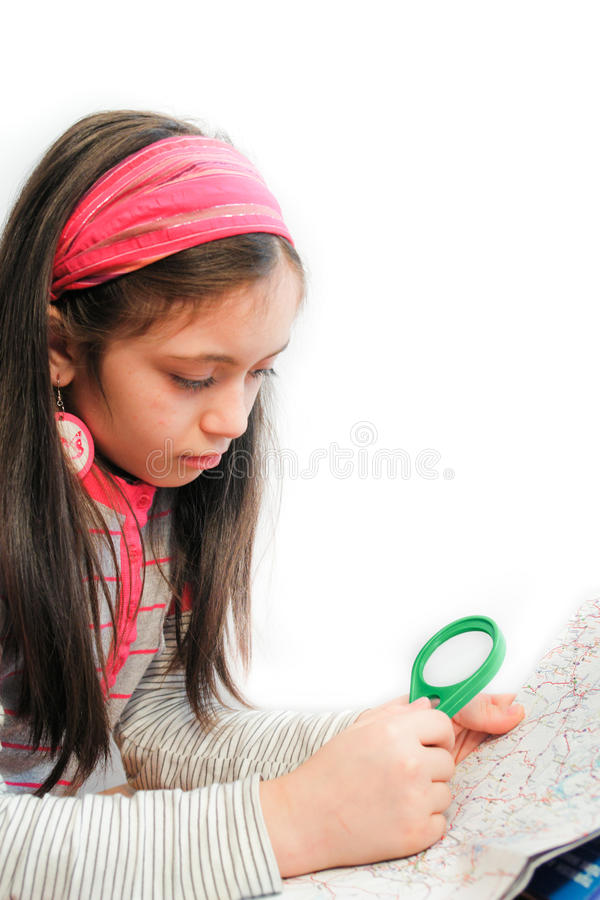 Little girl look for destination on a map royalty free stock photos