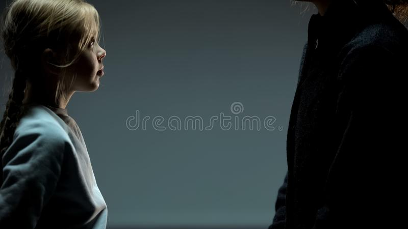 Little girl looking at adult woman, orphan child finding mother, togetherness. Stock photo royalty free stock photo