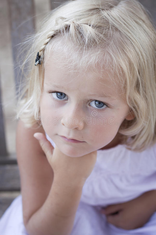 Little girl looking at camera stock photography