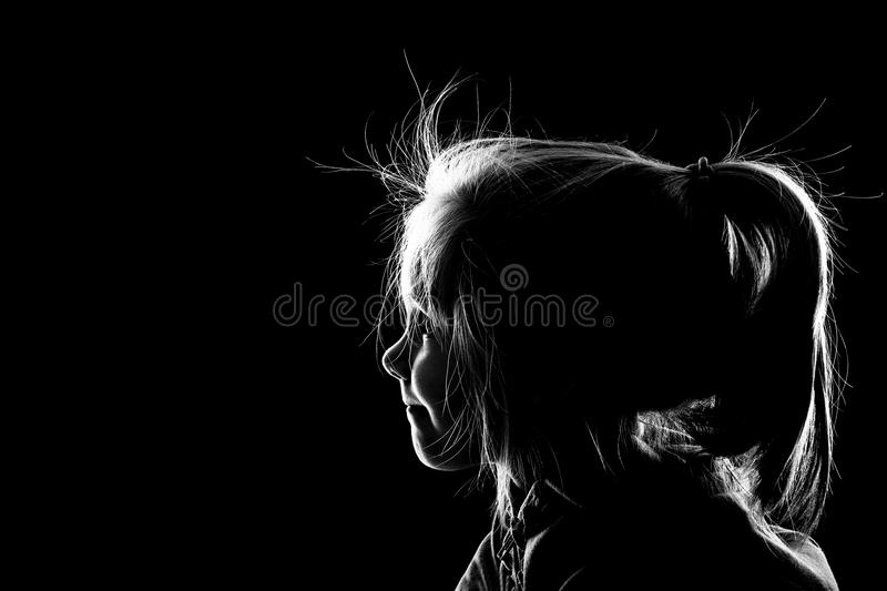 Little girl looking in the darkness royalty free stock images