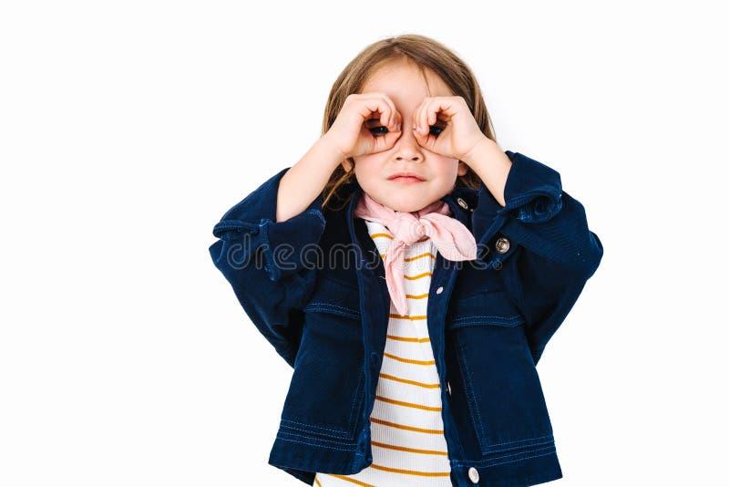 Little girl is looking through imaginary binocular stock photos