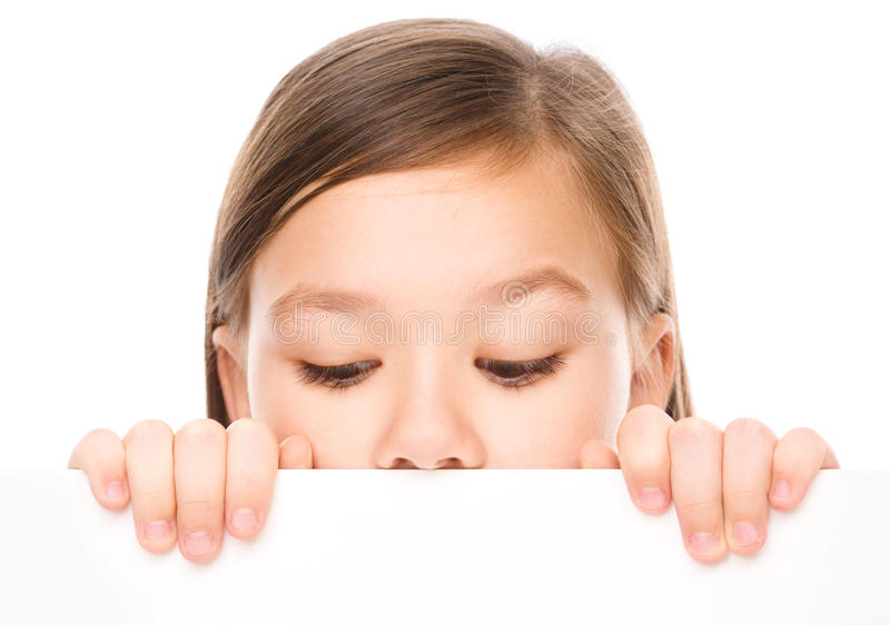 Little girl is looking from out blank board. Isolated over white stock photos