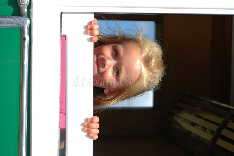 Little girl looking out train window royalty free stock images