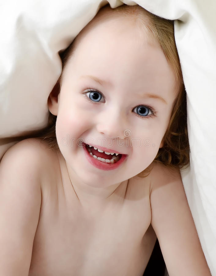 Download Little Girl Looking Out From Under Blanket Stock Photo - Image: 21803508