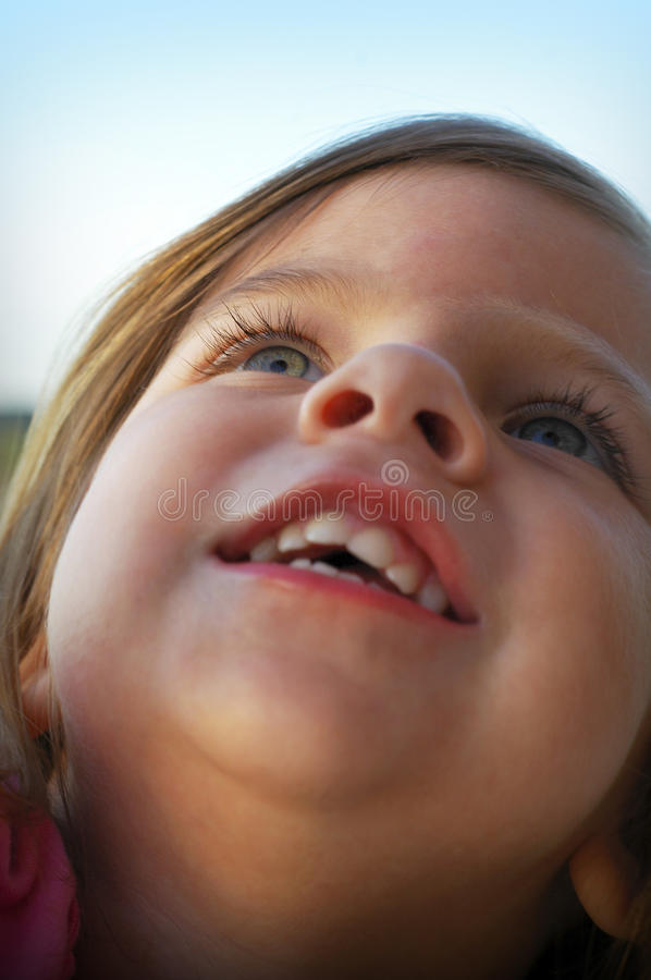 Little girl looking up royalty free stock photography