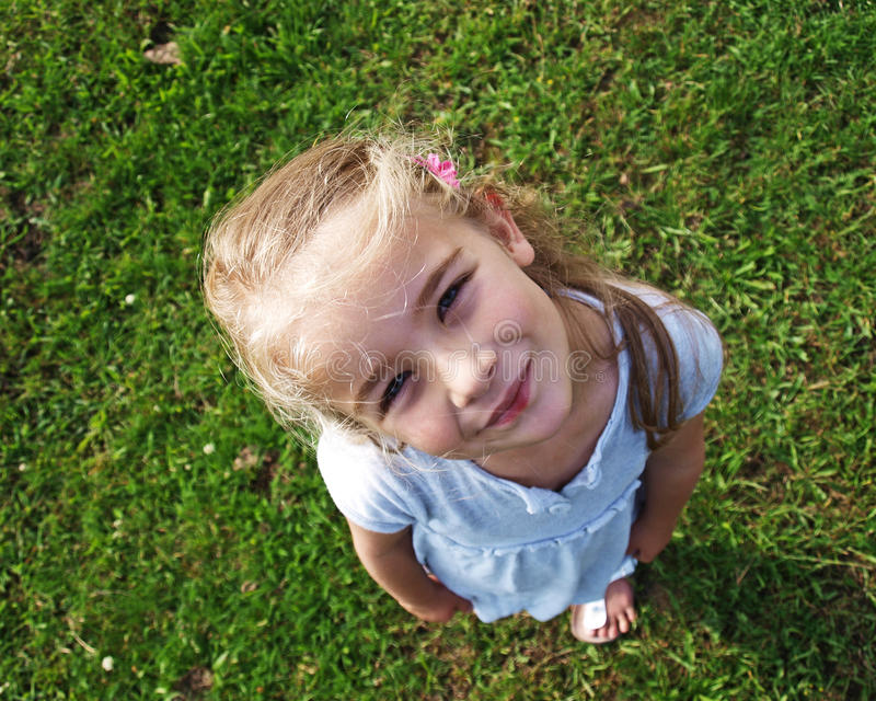 Little girl looking up stock images